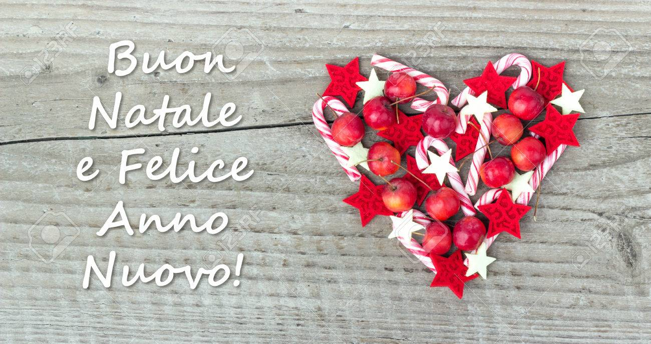 Italy christmas card with candy canes apples and text merry stock italy christmas card with candy canes apples and text merry christmas and a happy new m4hsunfo