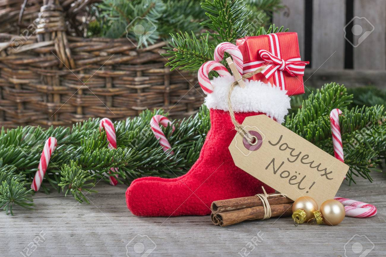 French christmas card with red sock gifts candy canes and text french christmas card with red sock gifts candy canes and text merry christmas stock m4hsunfo