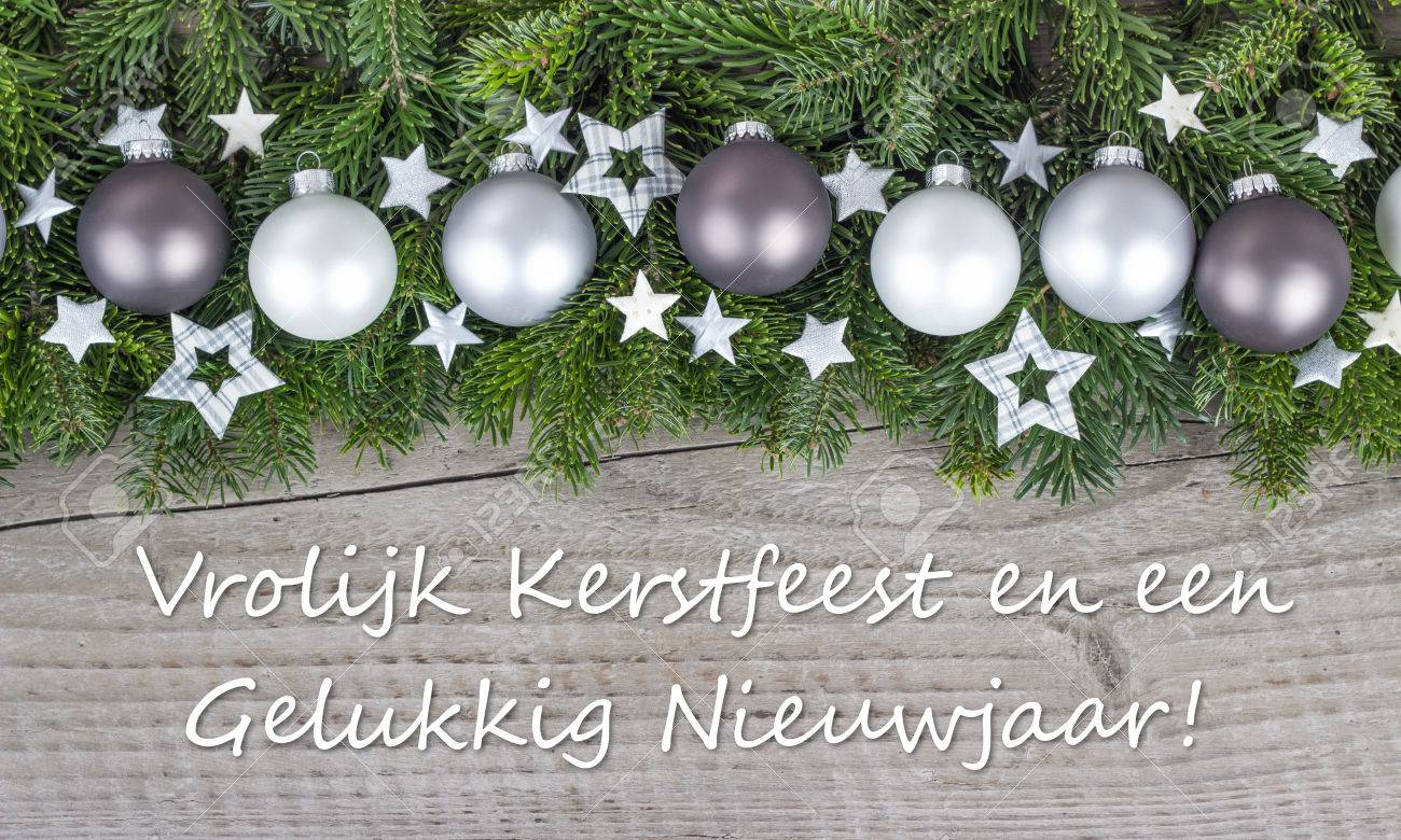 Dutch christmas card with christmas baubles fir branches stars dutch christmas card with christmas baubles fir branches stars and text merry christmas and m4hsunfo