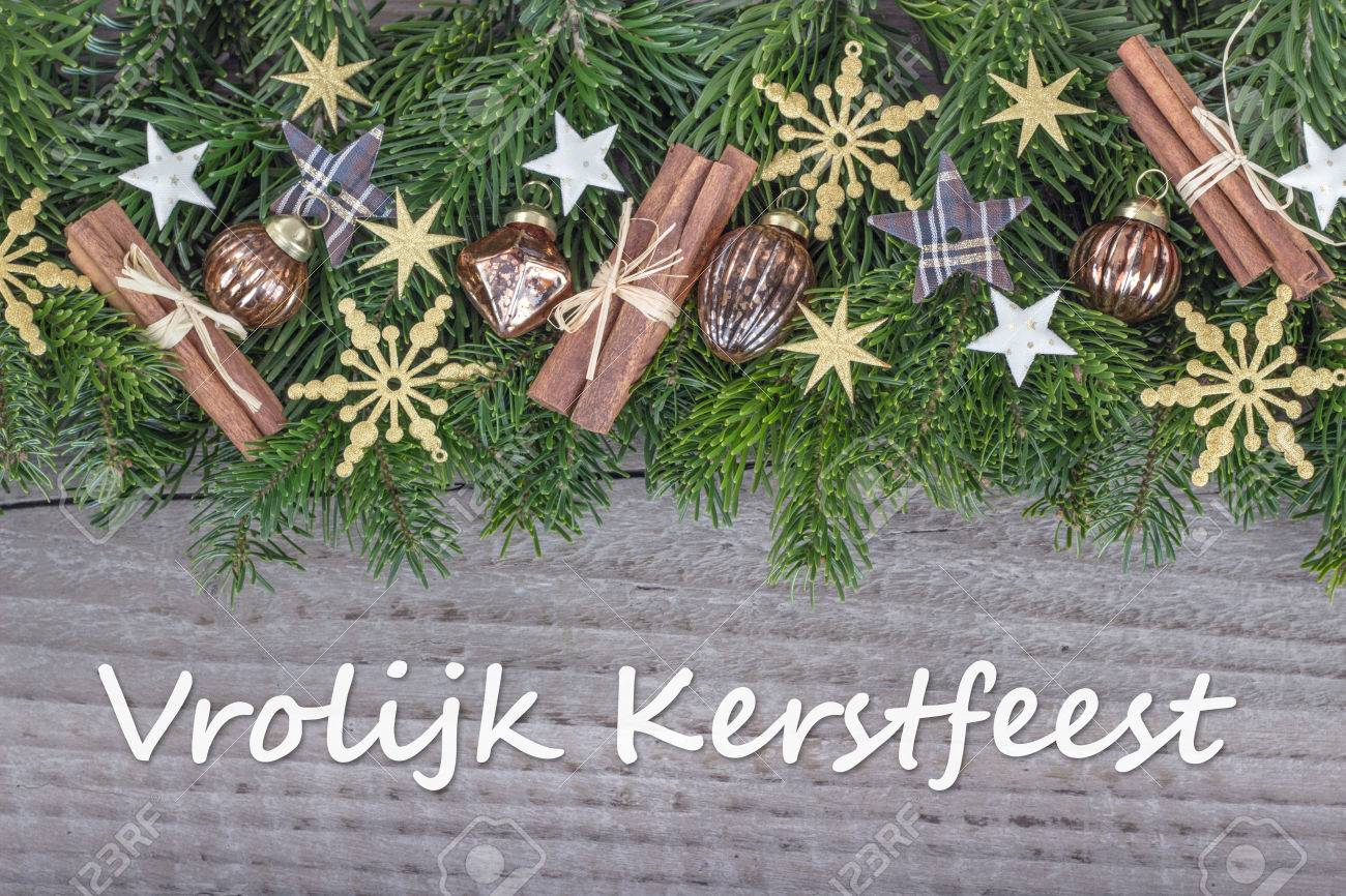 Dutch christmas card with christmas baubles fir branches stars dutch christmas card with christmas baubles fir branches stars and text merry christmas stock photo m4hsunfo