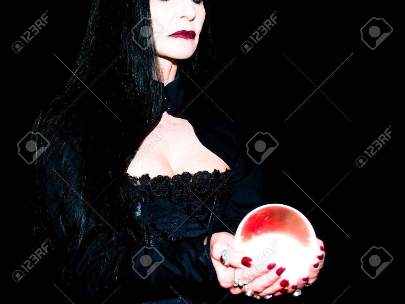 A crystal ball is held in the hands of a fortune teller. Stock Photo - 998670