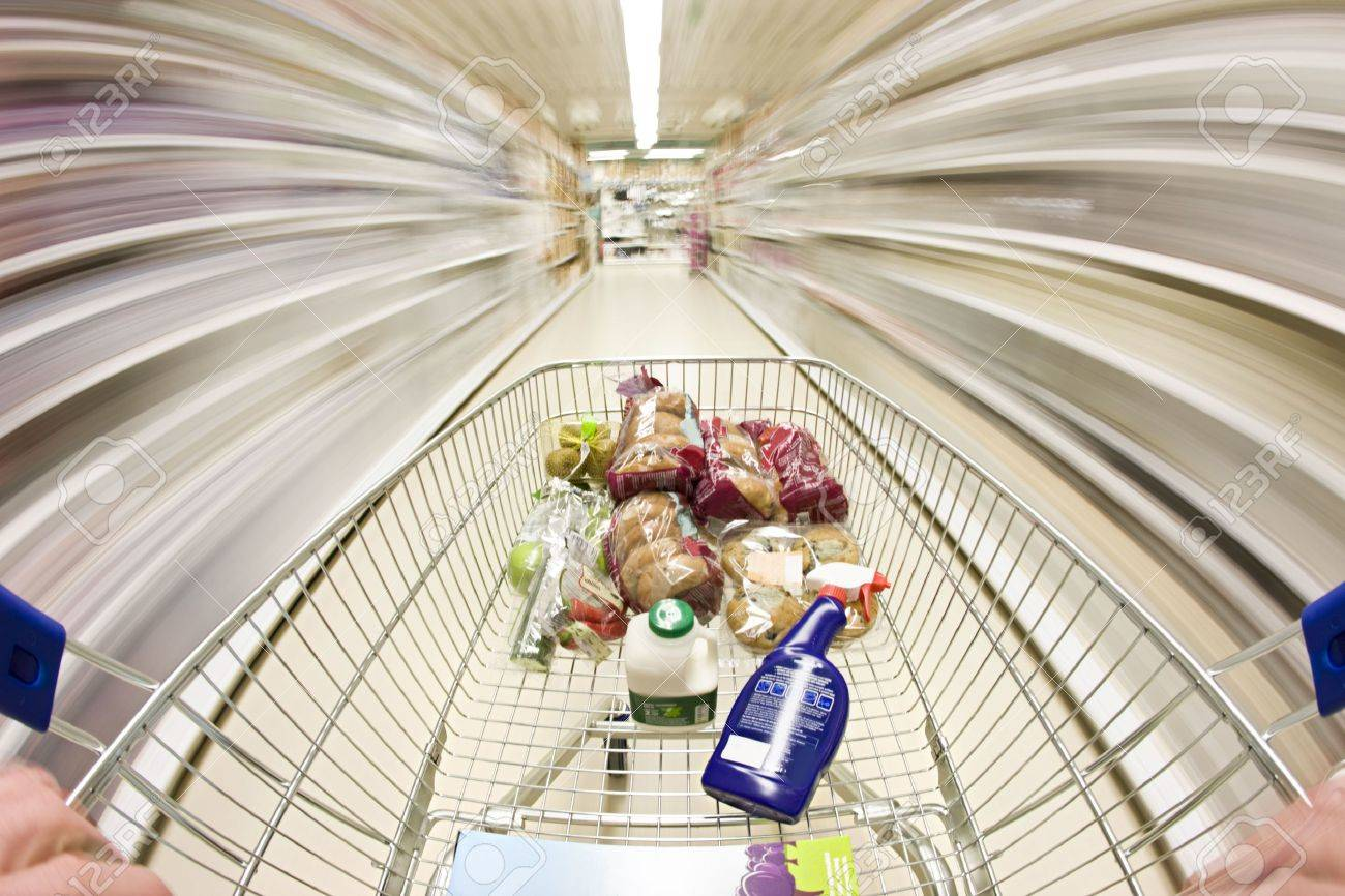 shopping cart in motion around the supermarket Stock Photo - 6685448