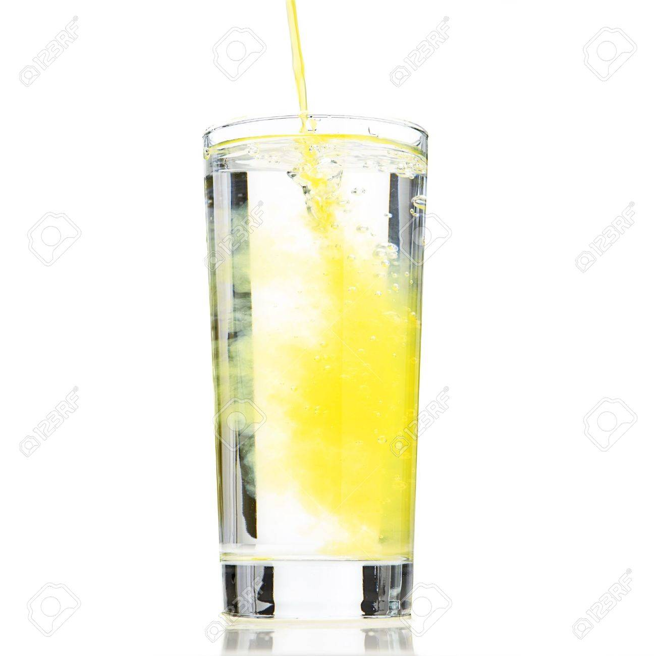 Glass of water been diluted to orange drink Stock Photo - 6685535