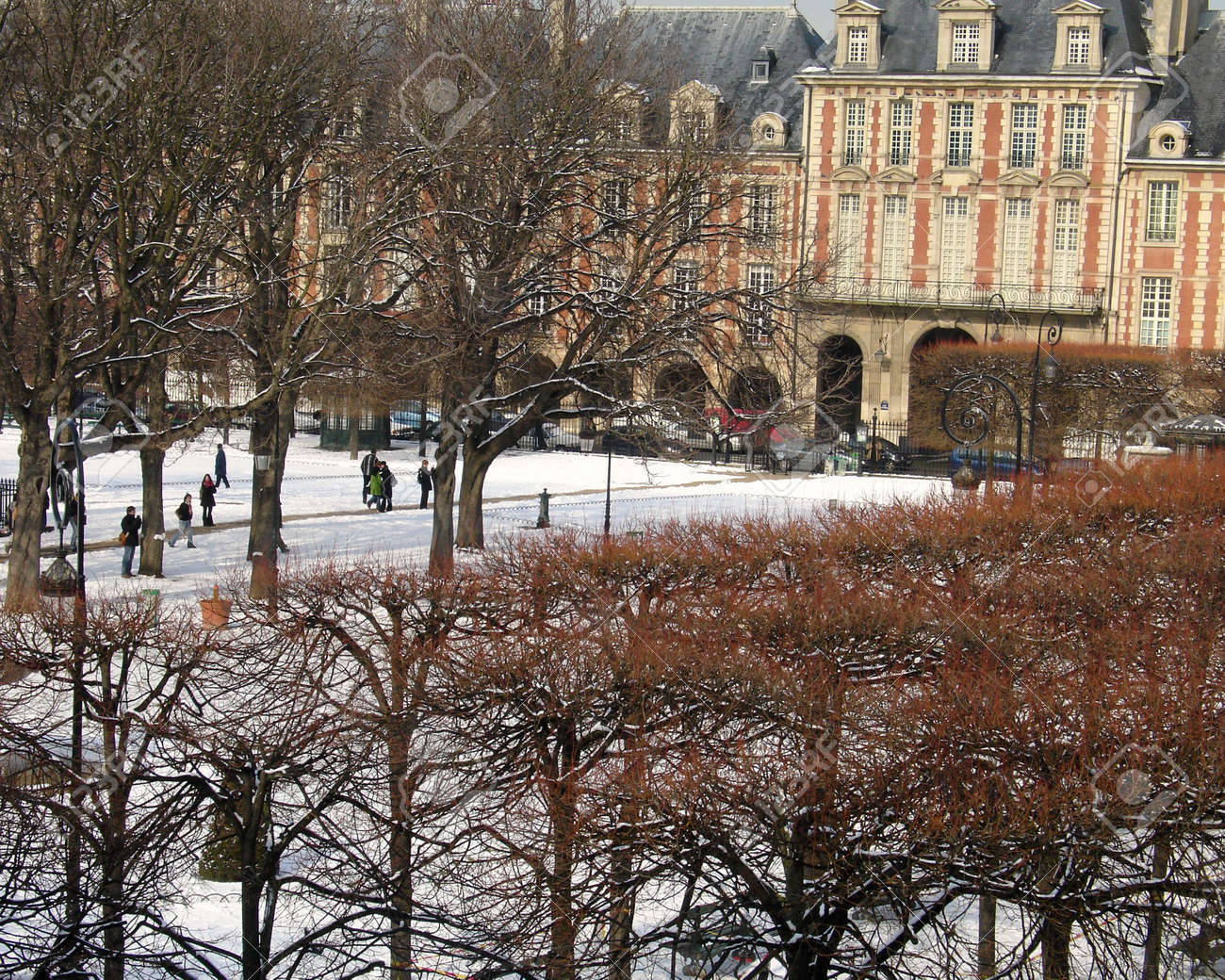 Paris France the Place Des Vosges Square with a covering of WInter Snow Stock Photo - 643125