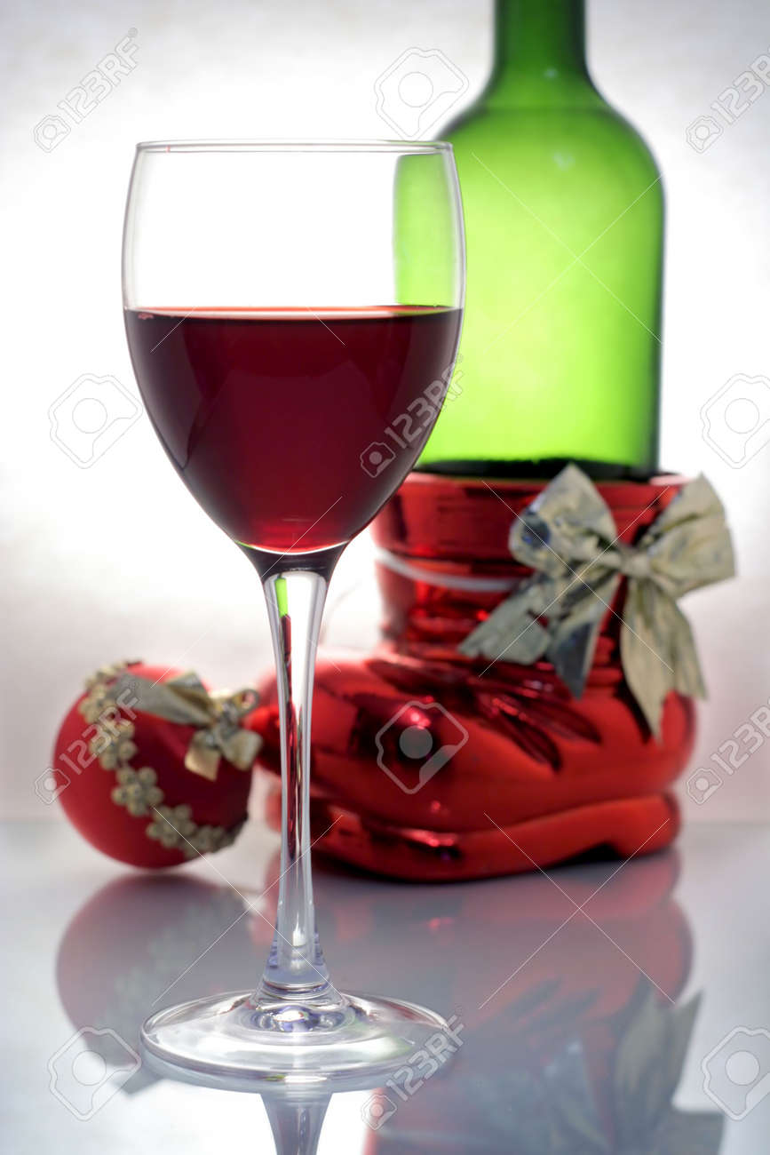 a glass of wine with bottle and christmas ball - 560071