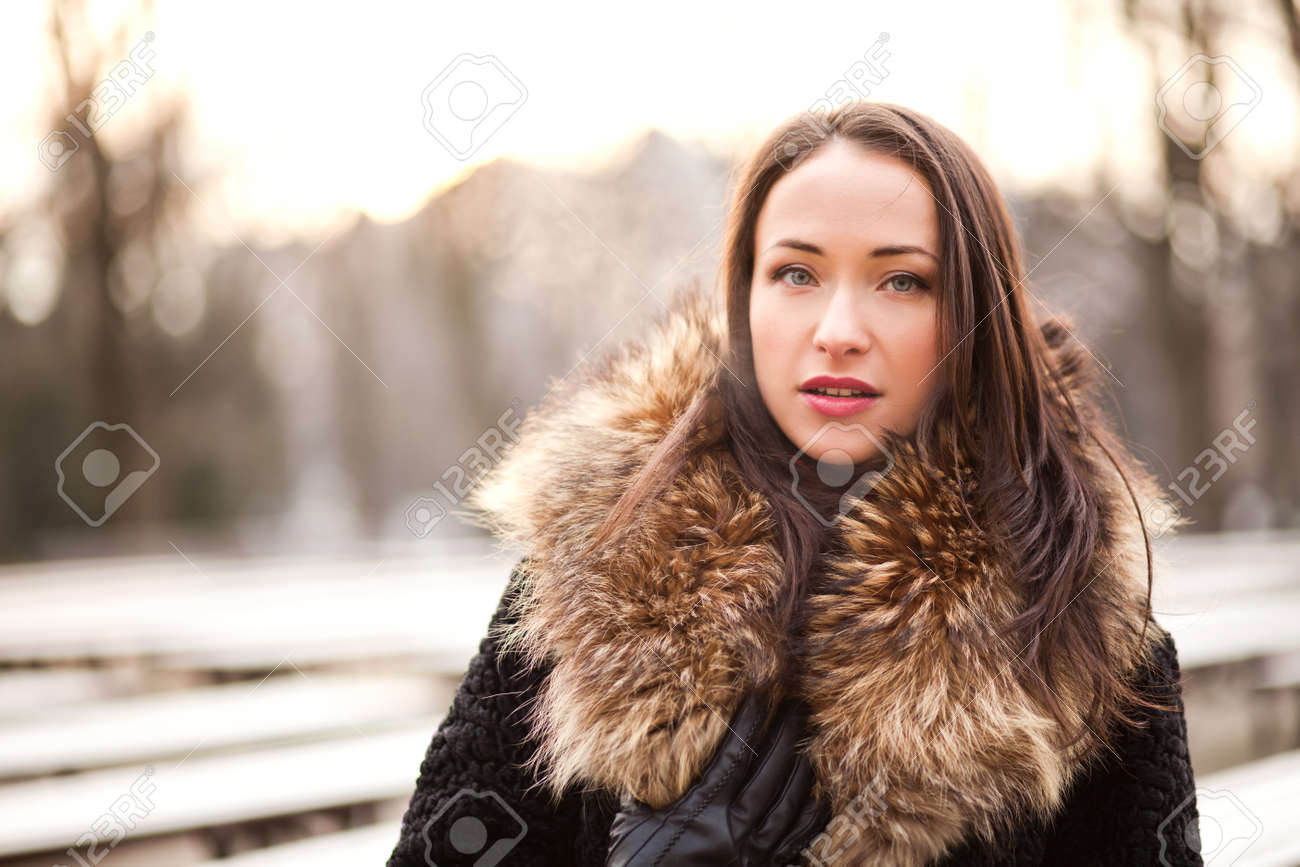 3efcbcf9d Beautiful lady is wearing a fur coat during the winter season Stock Photo -  26561378