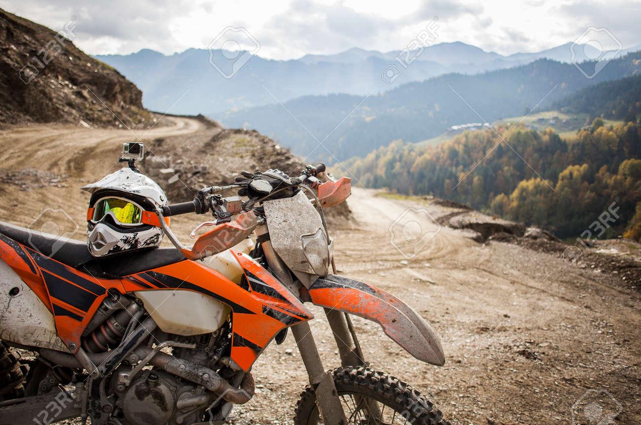 motocross. motocross: dirty enduro motorcycle motocross helmet on road stock photo