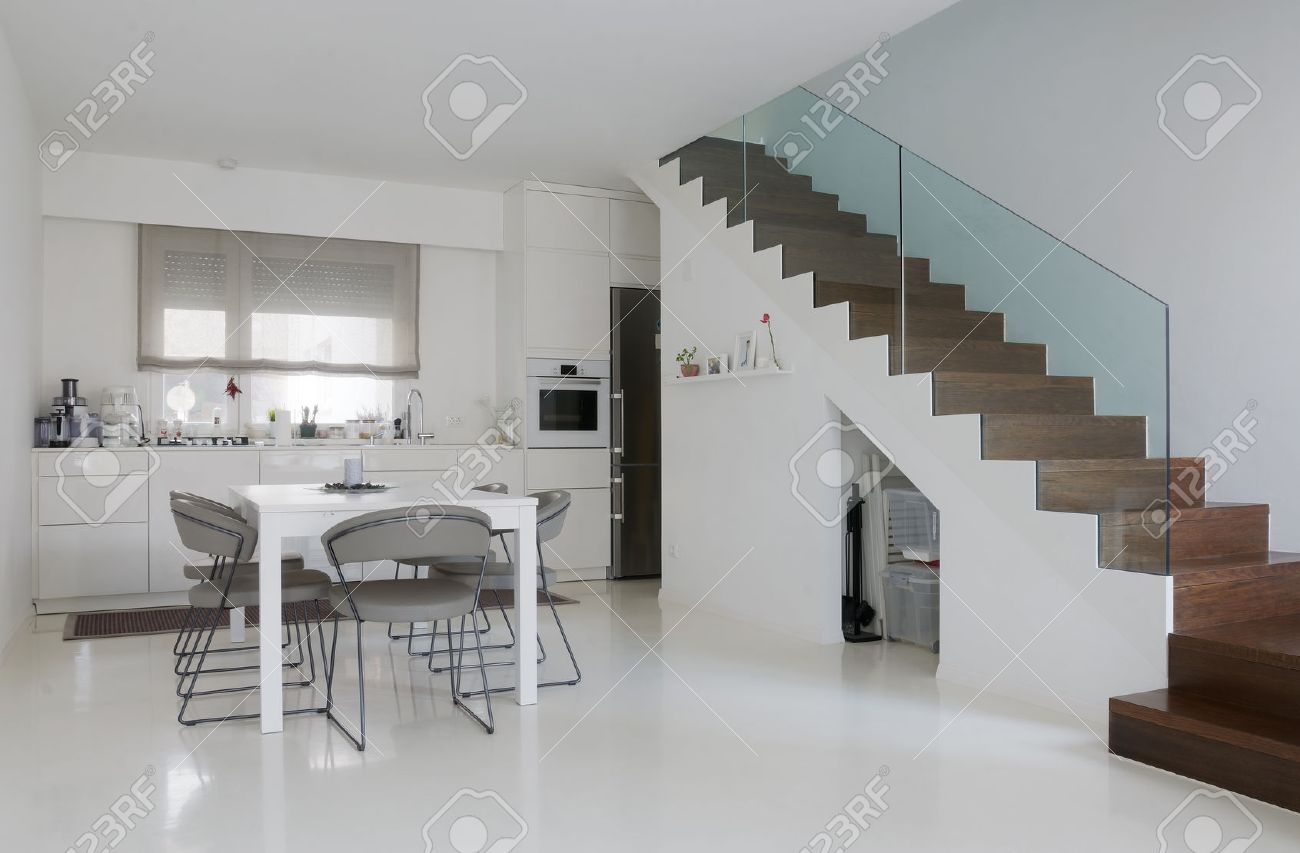 white kitchen and dining room with white epoxy floor and wooden..