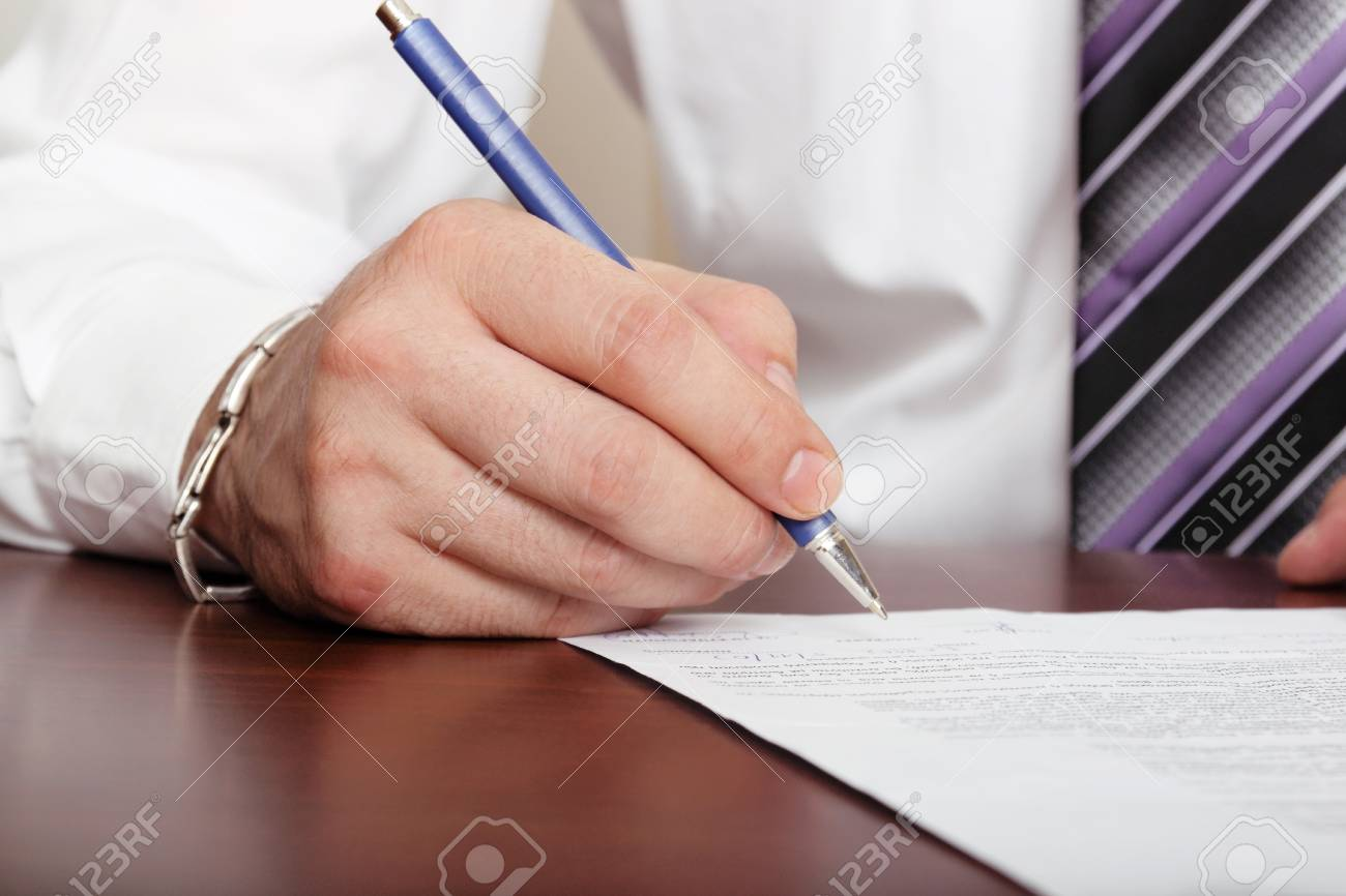 man is signing a document Stock Photo - 14501183
