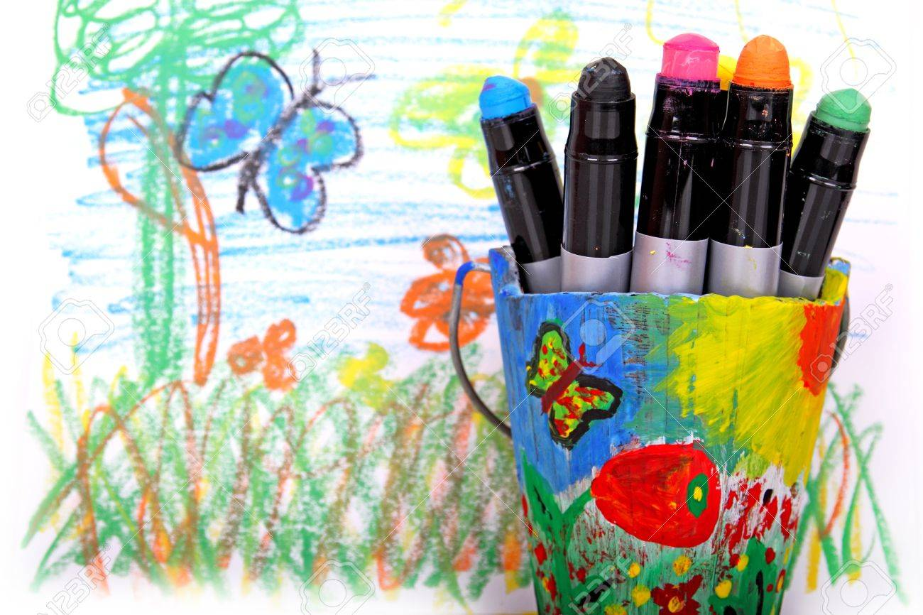 wax crayons in bucket against abstract drawing Stock Photo - 14501177