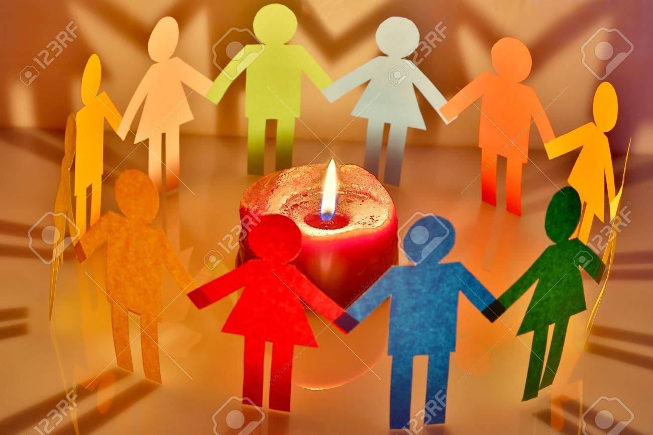 paper people around a burning candle Stock Photo - 18540617