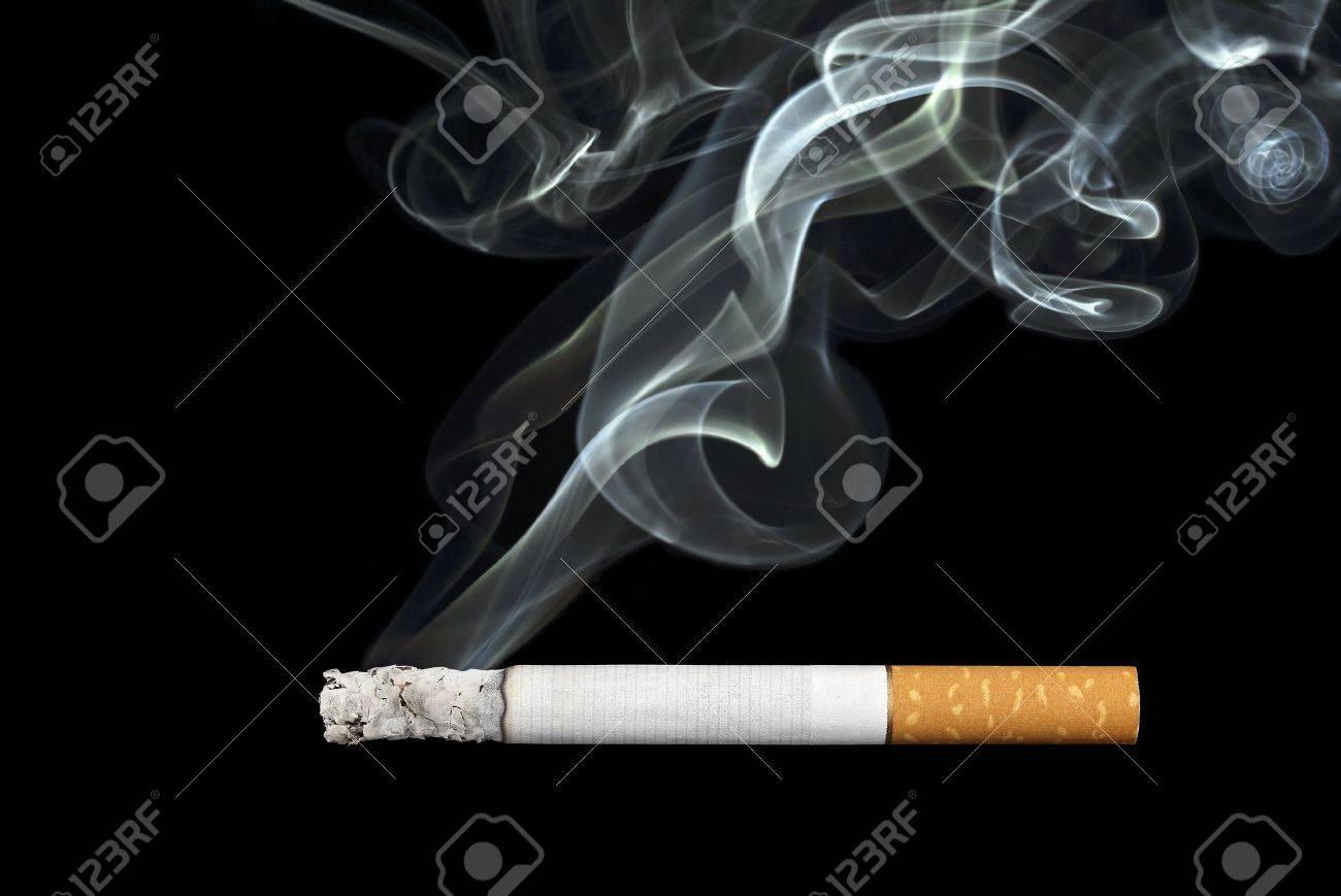 smoking cigarette on black background - 21992879