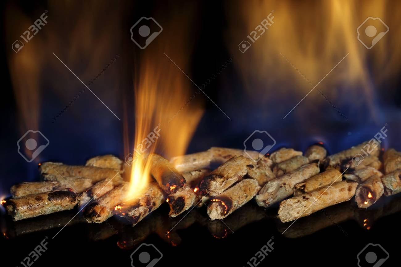 amount of burning wood pellets closeup - 33248135