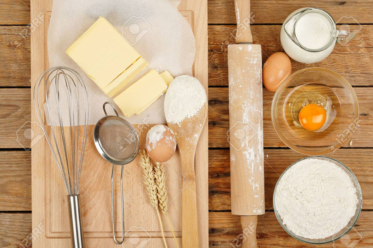 baking preparation, top view of a variety of objects on wooden planks - 36979206