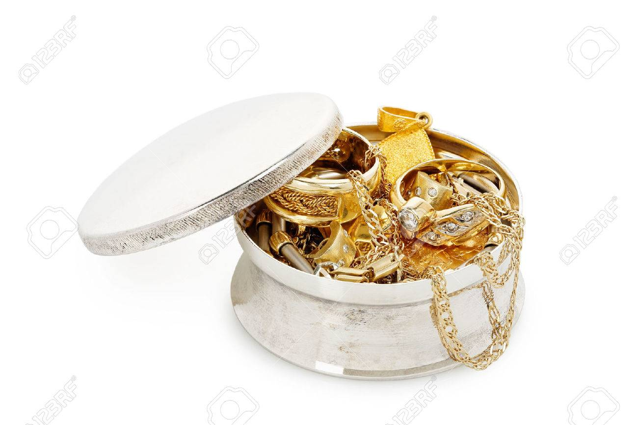 silver jewelry box with a variety of jewelry isolated on white - 38135507