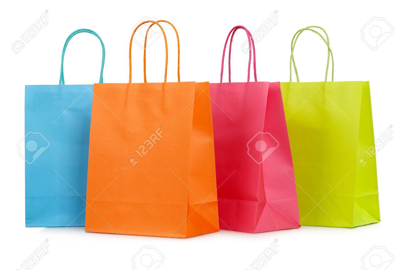 four colorful shopping bags closeup isolated on white - 41063839