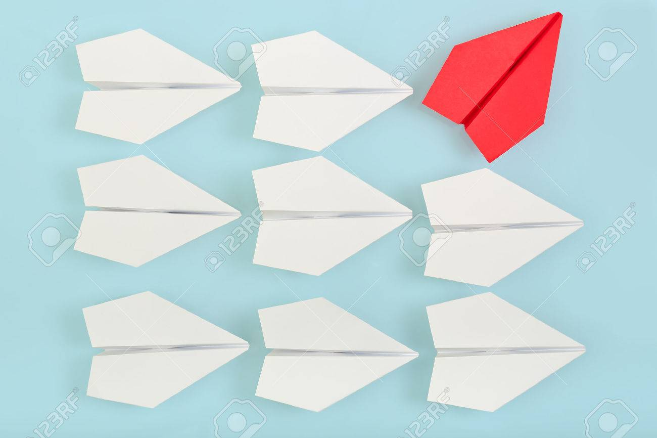 being different concept with red paper plane going in a different direction - 42303367