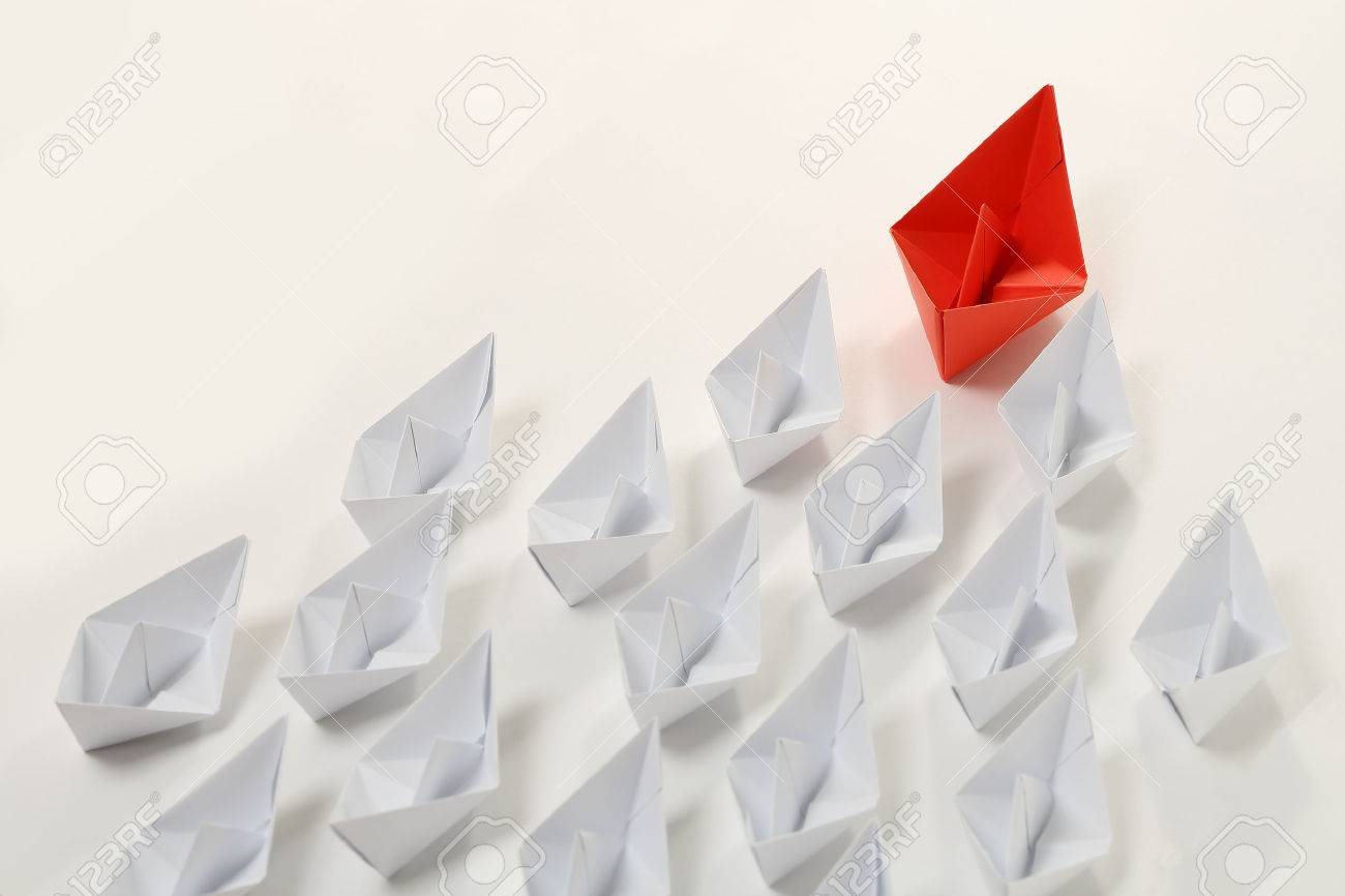 red paper boat leading white ones, leadership concept - 46102630