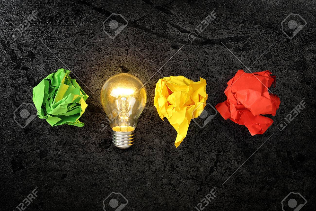 lit lightbulb with crumpled paper balls, idea or inspiration concept - 47213702