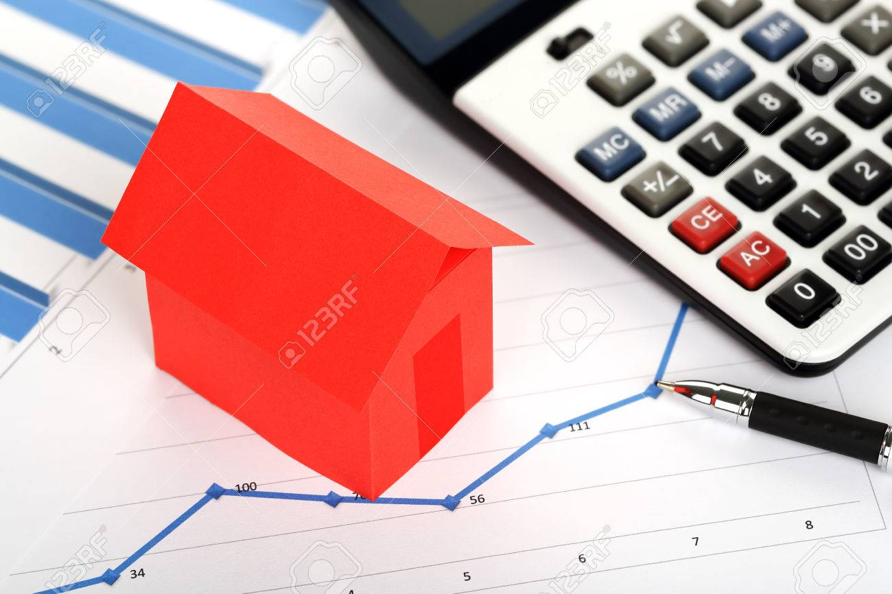 red paper house and calculator on graphs, real estate concept - 48929773