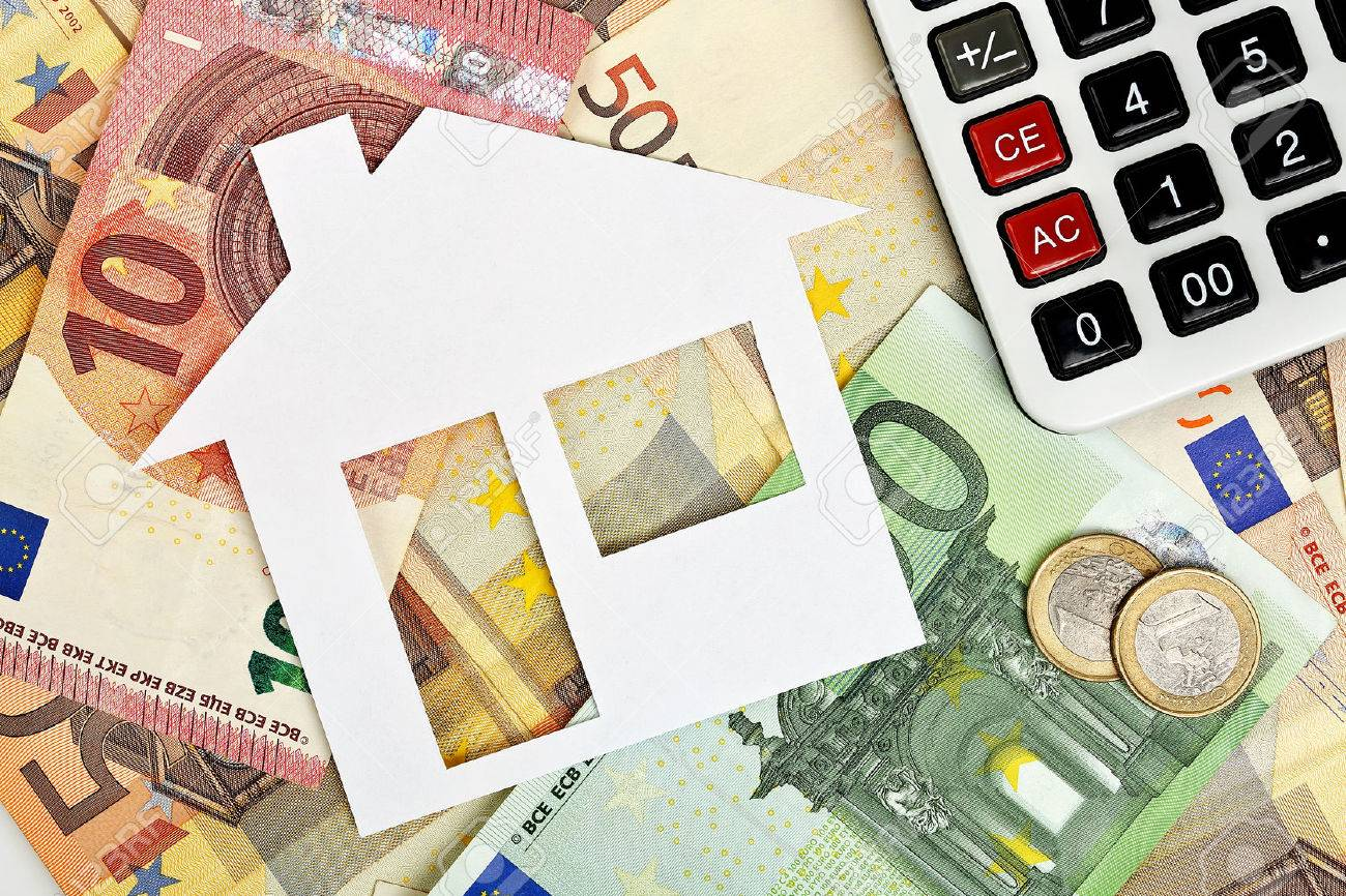 paper house with euro banknotes and calculator - 48929775