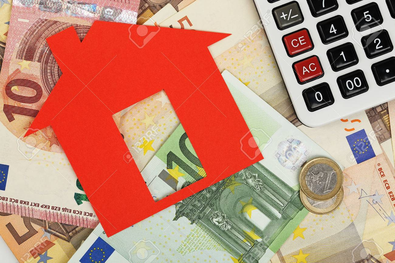 red paper house with euro banknotes and calculator - 48929855