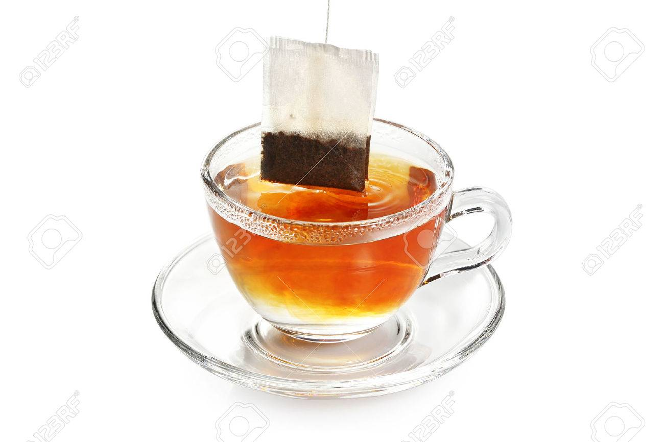 tea bag in transparent cup of tea isolated - 65190226