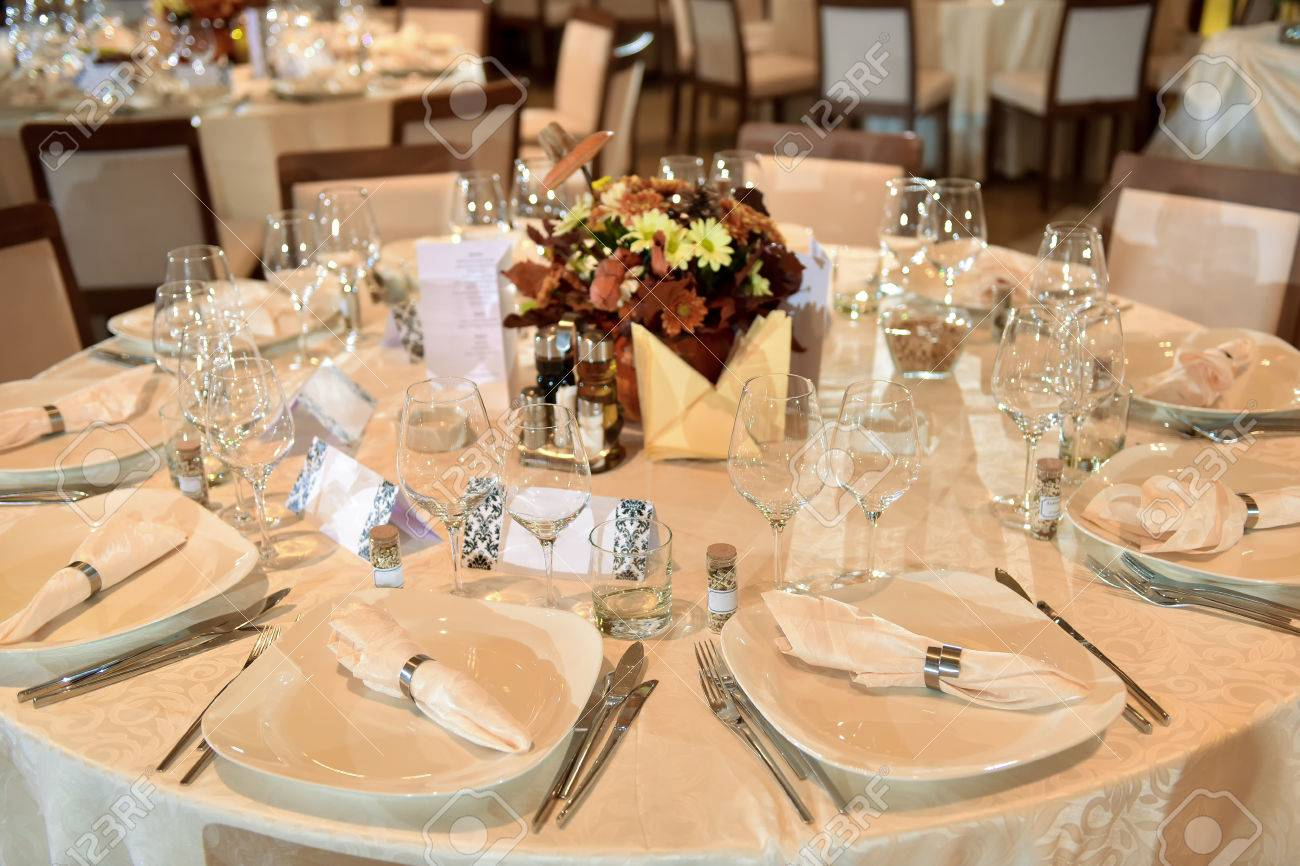 Setup Wedding Table With Plate, Fork, Knife And Glasses Stock