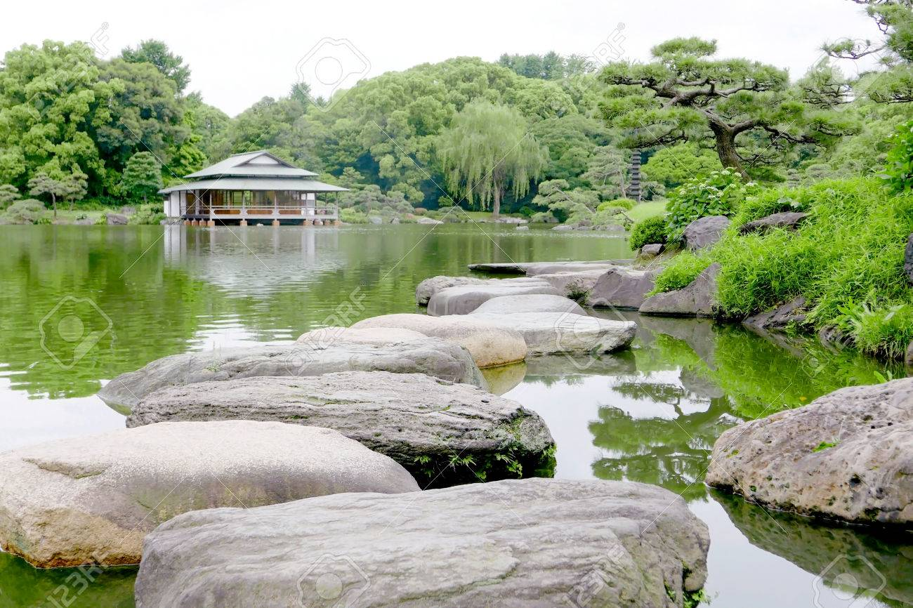 Japanese Pavilion Building, Stone Bridge,water Pond In The Zen Garden Stock  Photo