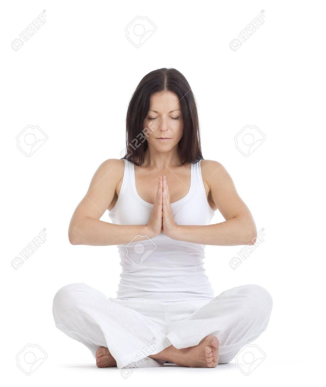 woman sitting on the floor exercising yoga - isolated on white Stock Photo - 10458242