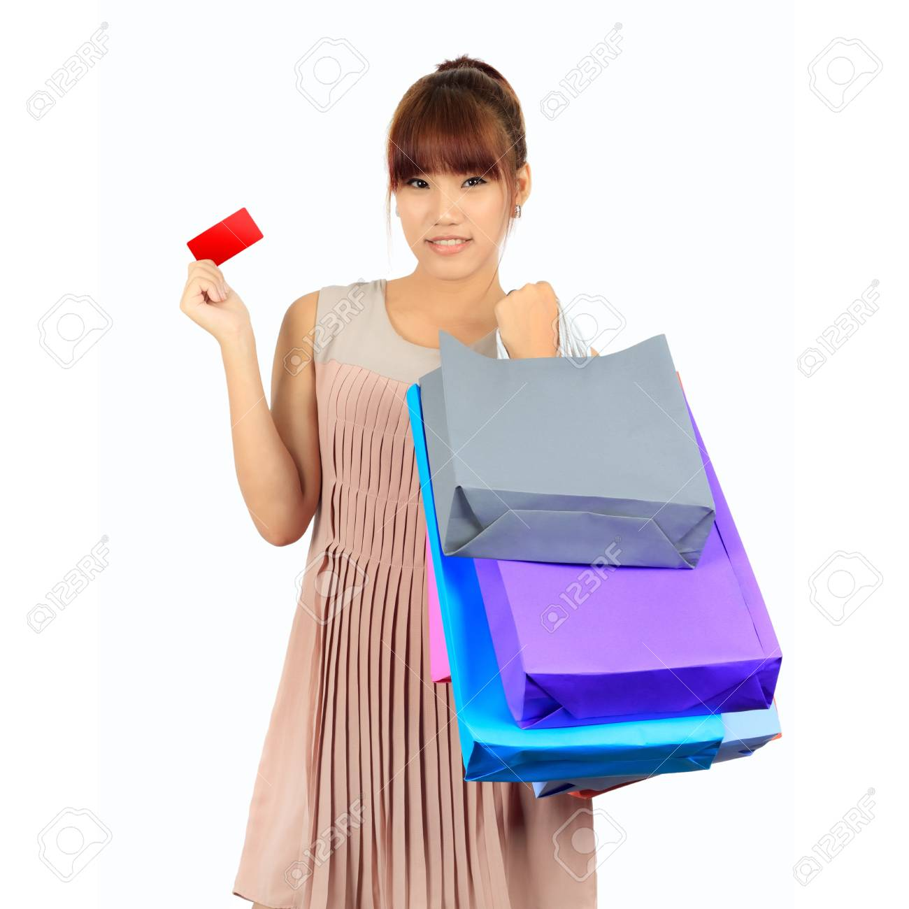 Isolated Yong Asian Woman With colorful Shopping Bags Stock Photo - 17500845