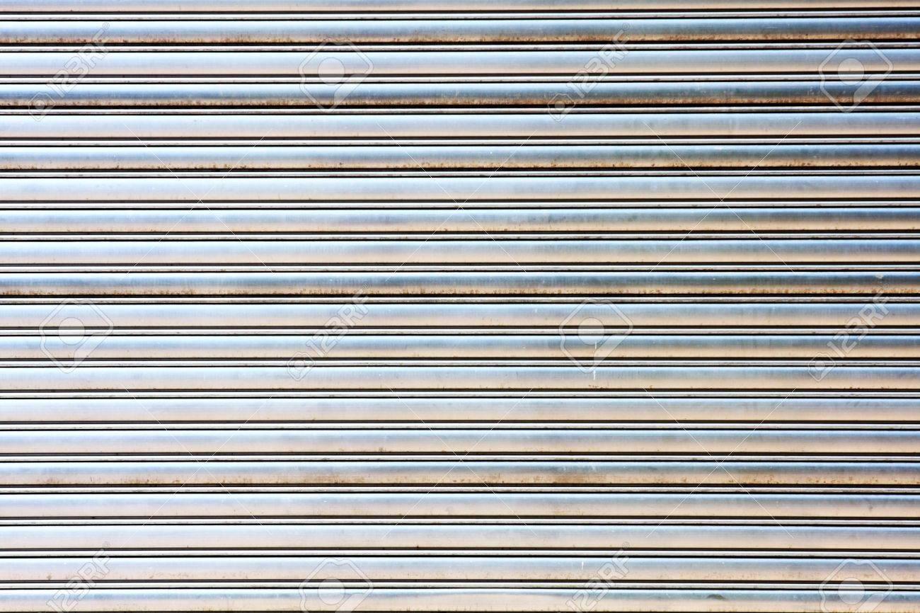 Stock Photo   Worn Metal Garage Door Gate Store Roller Shutter