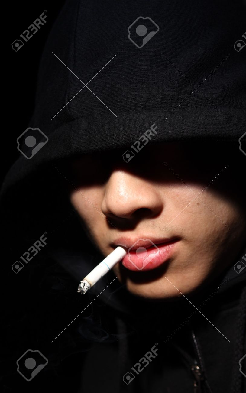 Monochrome picture of a guy in a hood Stock Photo - 9404993