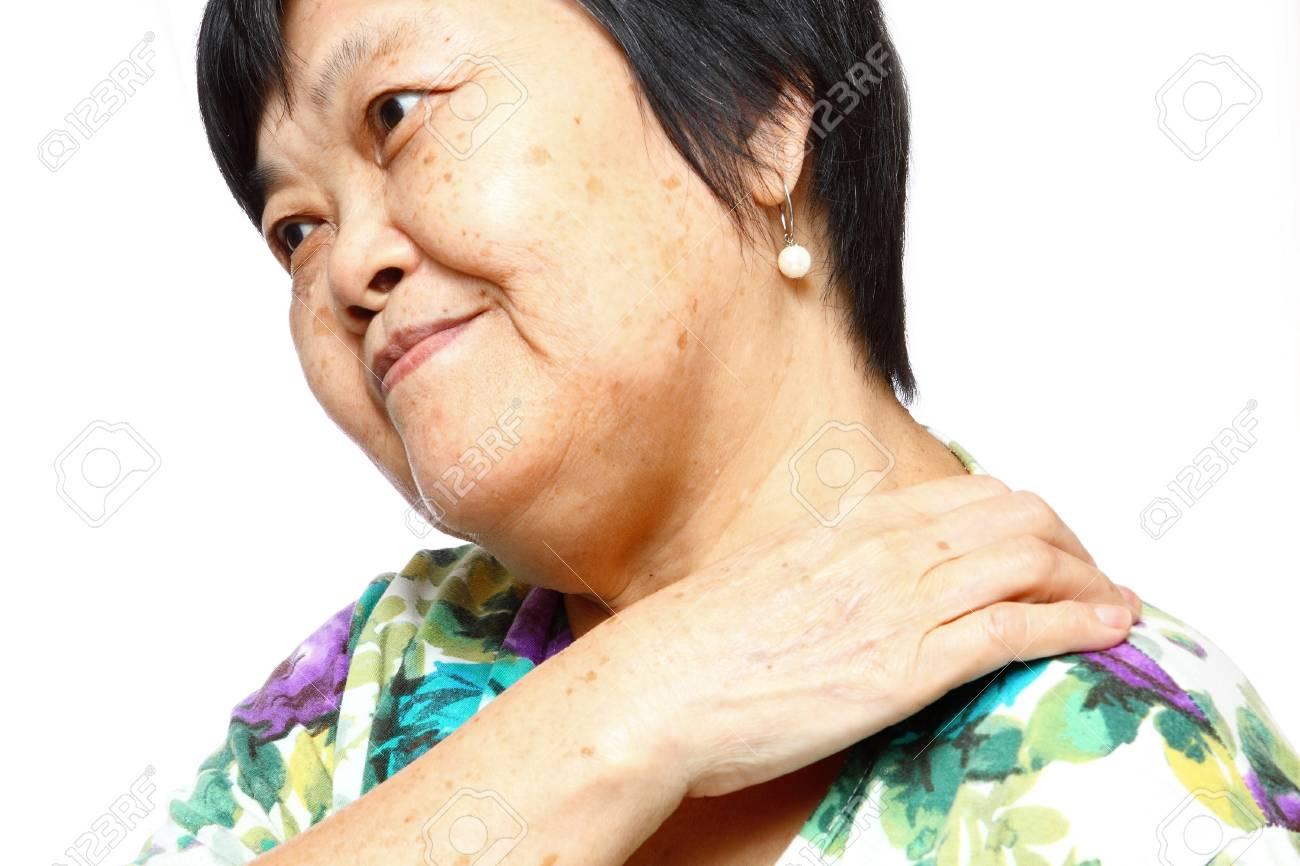senior woman holding her aching back , massage herself Stock Photo - 12748342