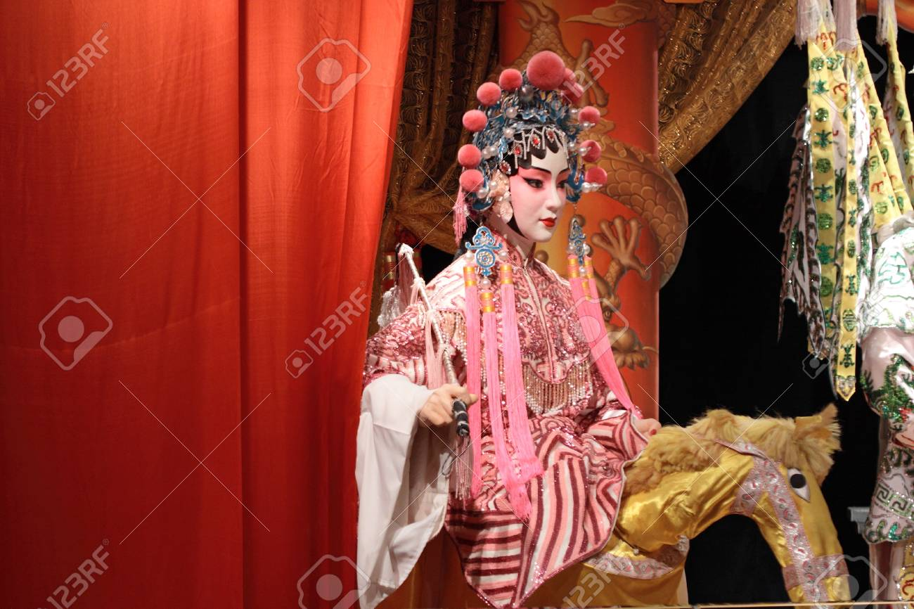 chinese opera dummy and red cloth as text space ,it is a toy,not real man  Stock Photo - 13161616