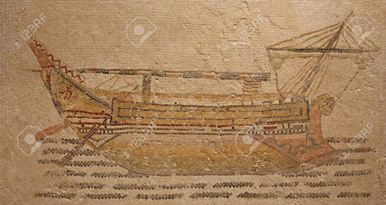 Ancient Roman mosaic from the beginning of the 3rd century depicting a stocky merchant ship was found at the threshold to the frigidarium of Themetra known as modern day Chott Merium in Tunisia - 24820351