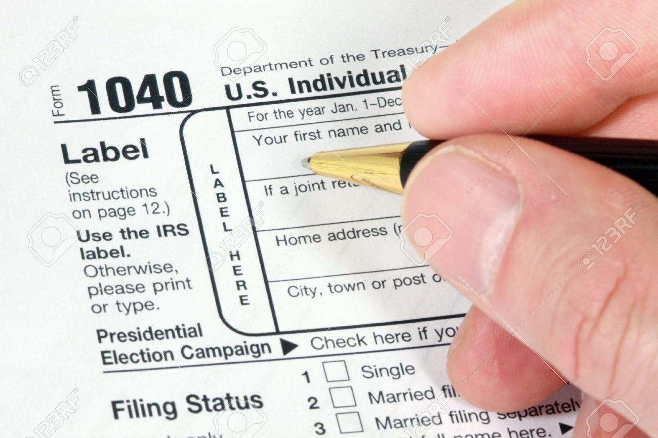 Filling out 1040 form for tax return stock photo picture and filling out 1040 form for tax return stock photo 2705202 falaconquin