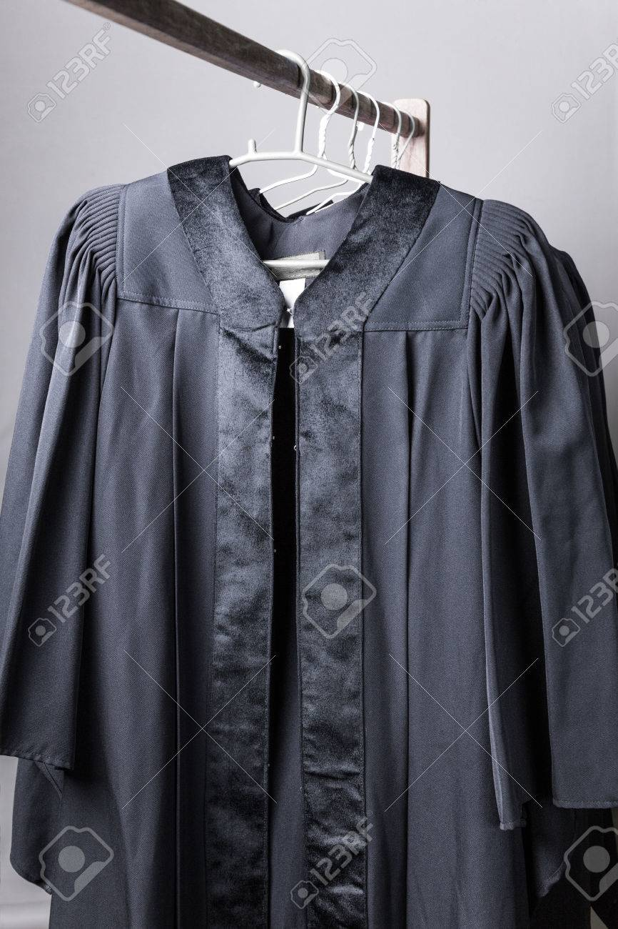 Black Graduation Gowns Hanging On Cloth Hangers On Wooden Rail Stock ...