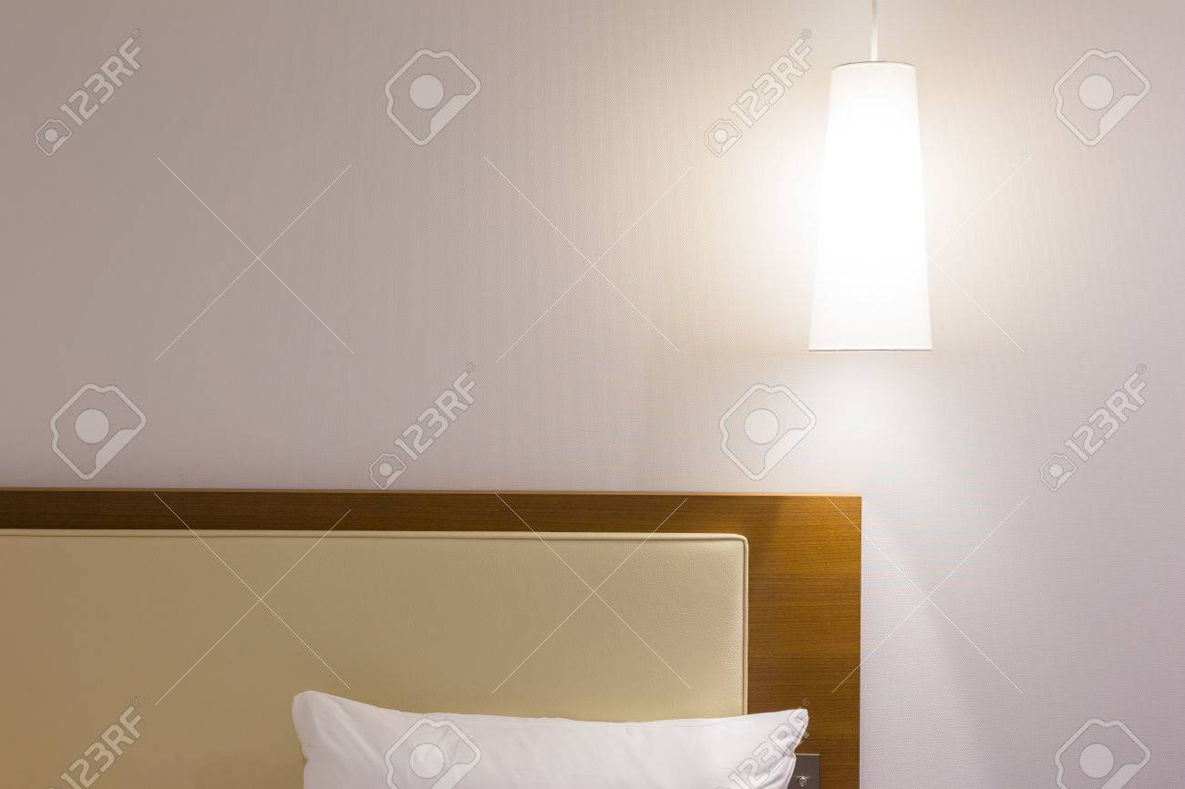 Bed Headboard White Pillow And Over Head Lamp In Simple And Stock Photo Picture And Royalty Free Image Image 61800266