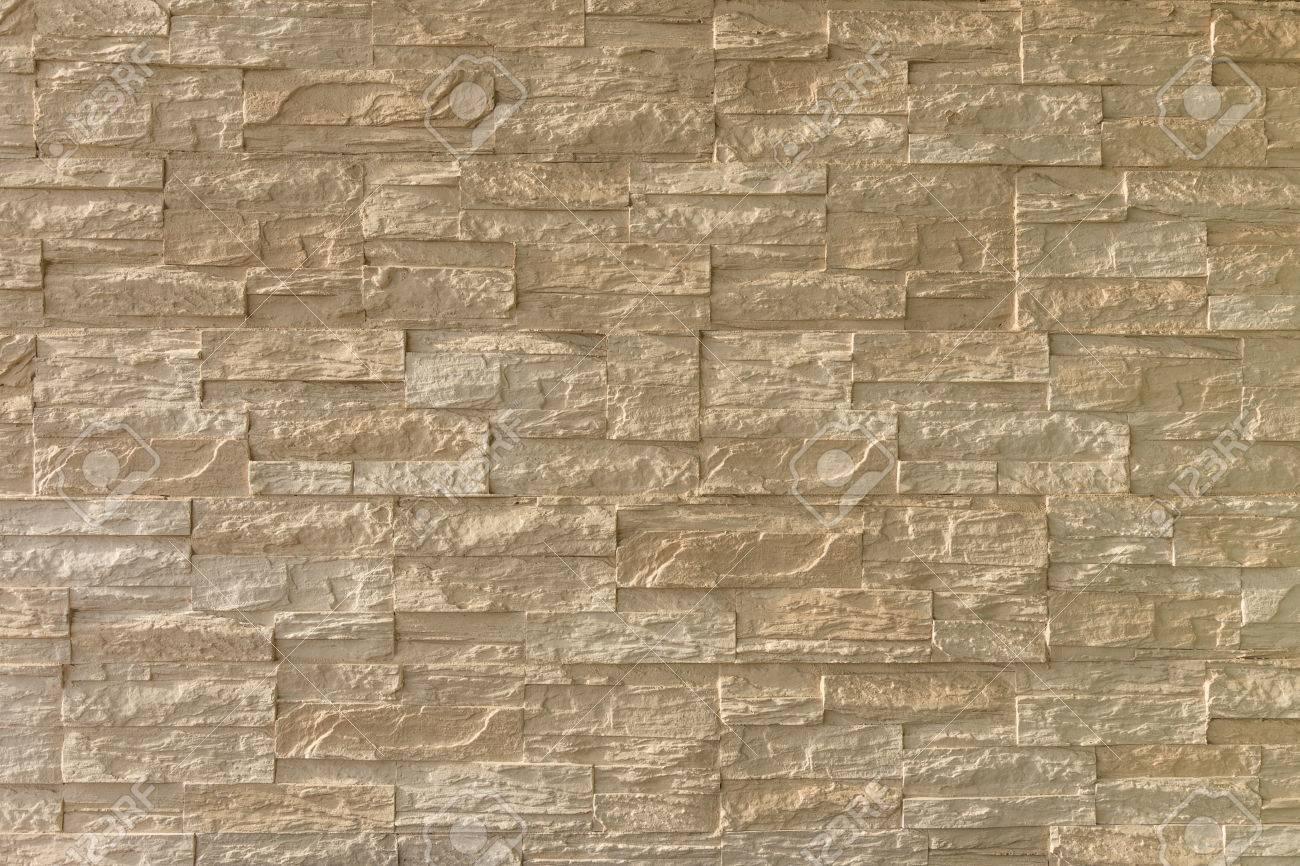 Pared Exterior De Piedra Marron Ladrillo Luz En Luz Dura Destacando - Piedra-pared-exterior