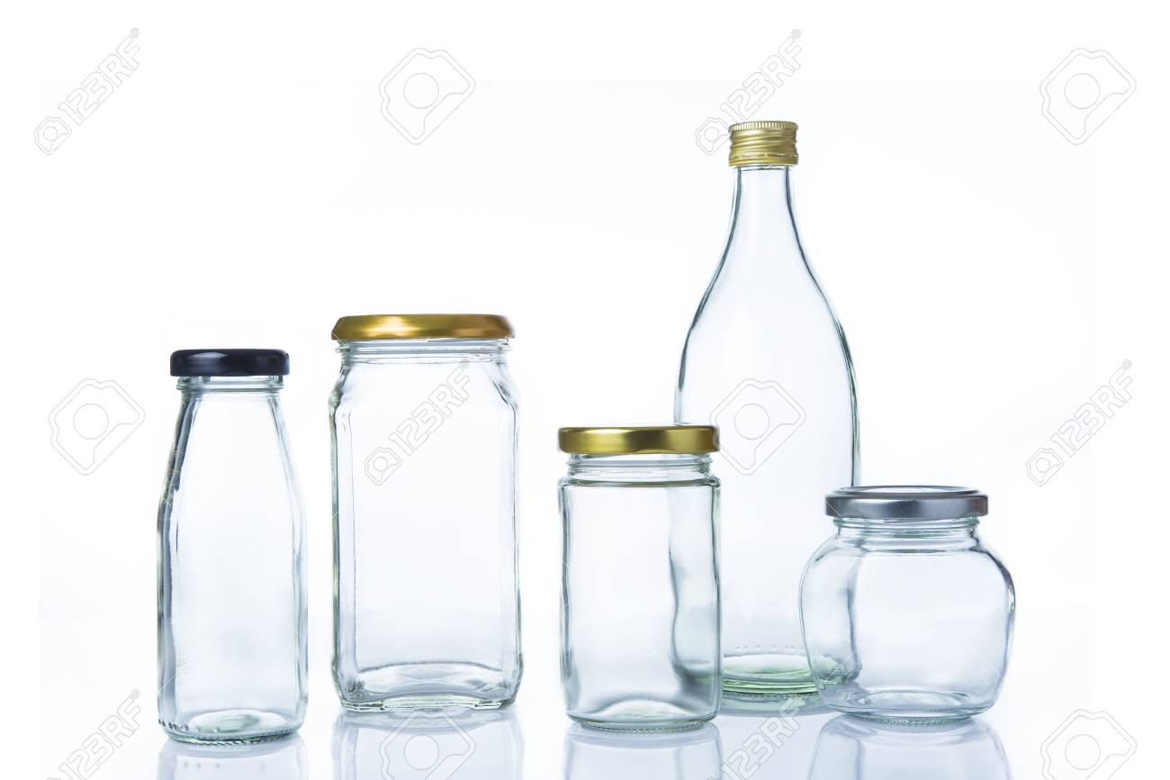 6c20647f3096 Empty clear glass bottles in various sizes and shapes with lids..