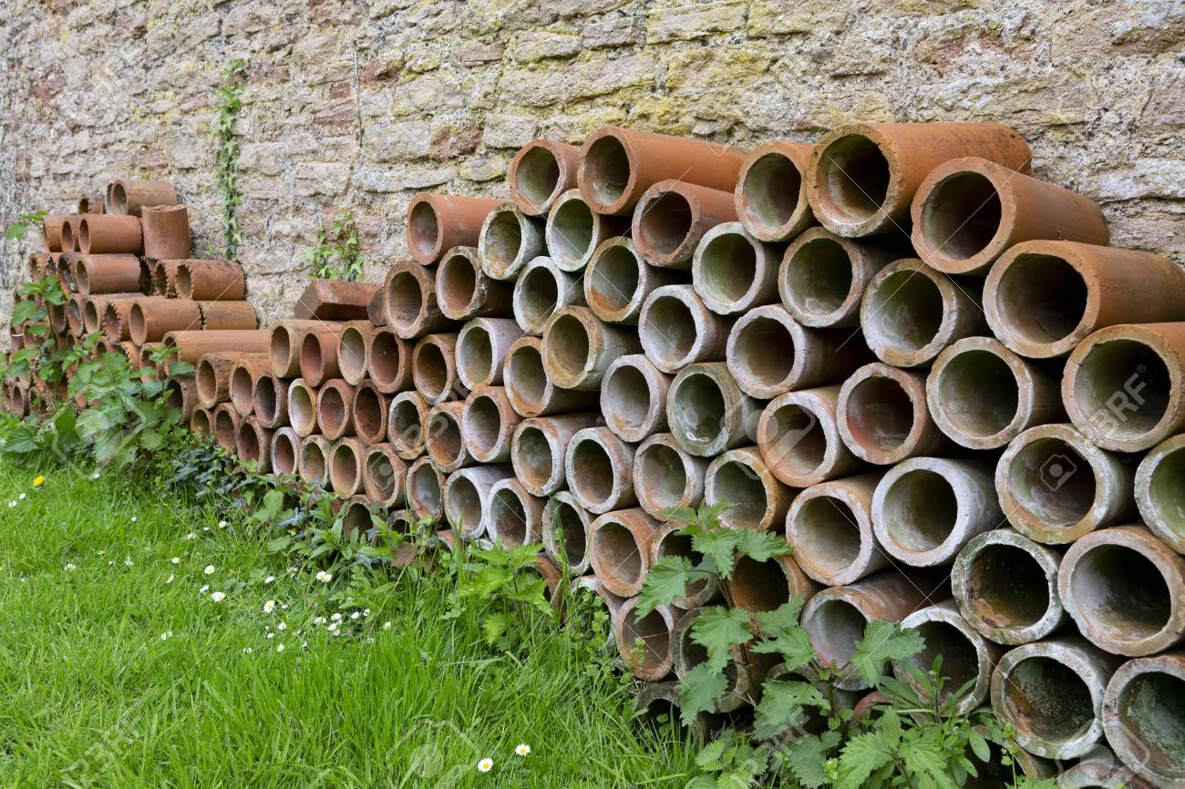 A Stack Of Terracotta Tube Planters For Growing Plants Stacked