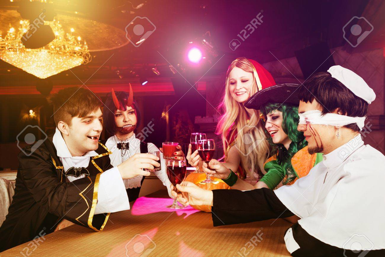 Group Of Friends Having Party In Halloween Costumes At Night ...