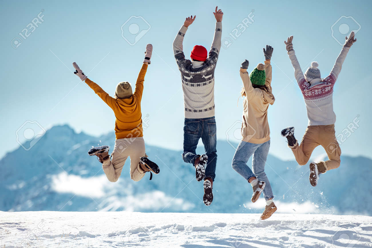 Friends celebrates beginning of winter in mountains, jumps and having fun - 158053518