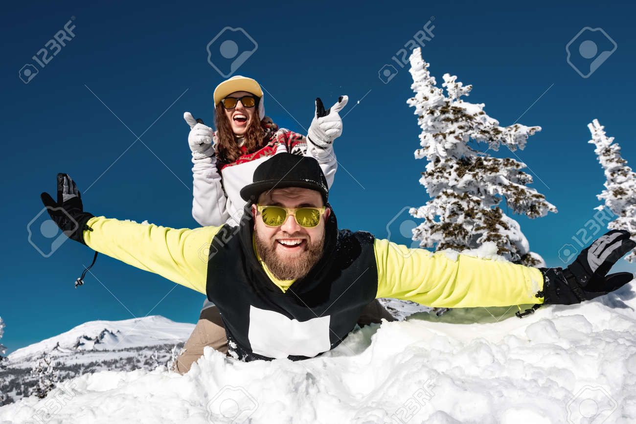Couple snowboarders or skiers are having fun at ski resort. Sheregesh, Siberia, Russia - 165286916
