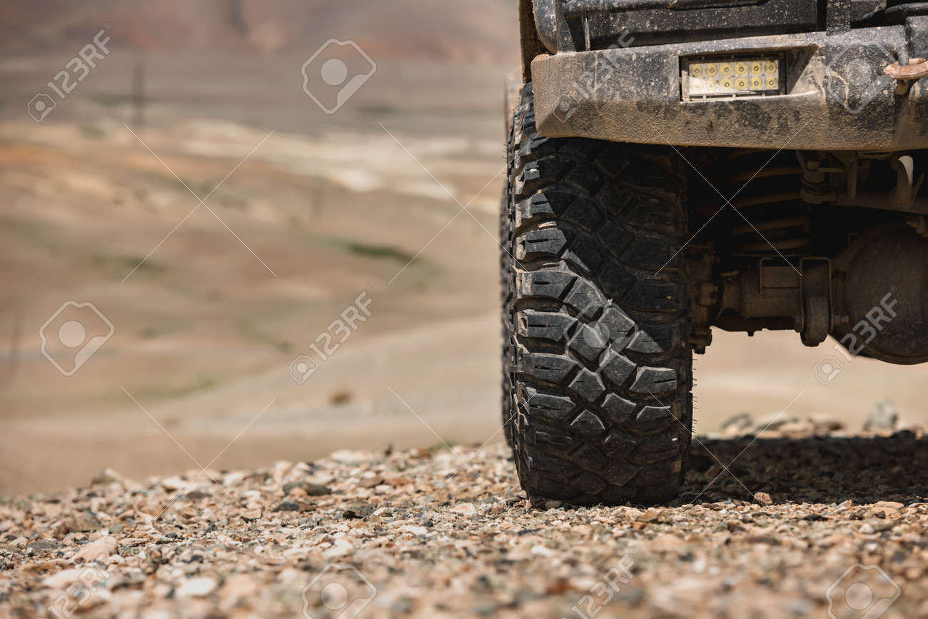 Close up photo of offroad car wheel - 165803296