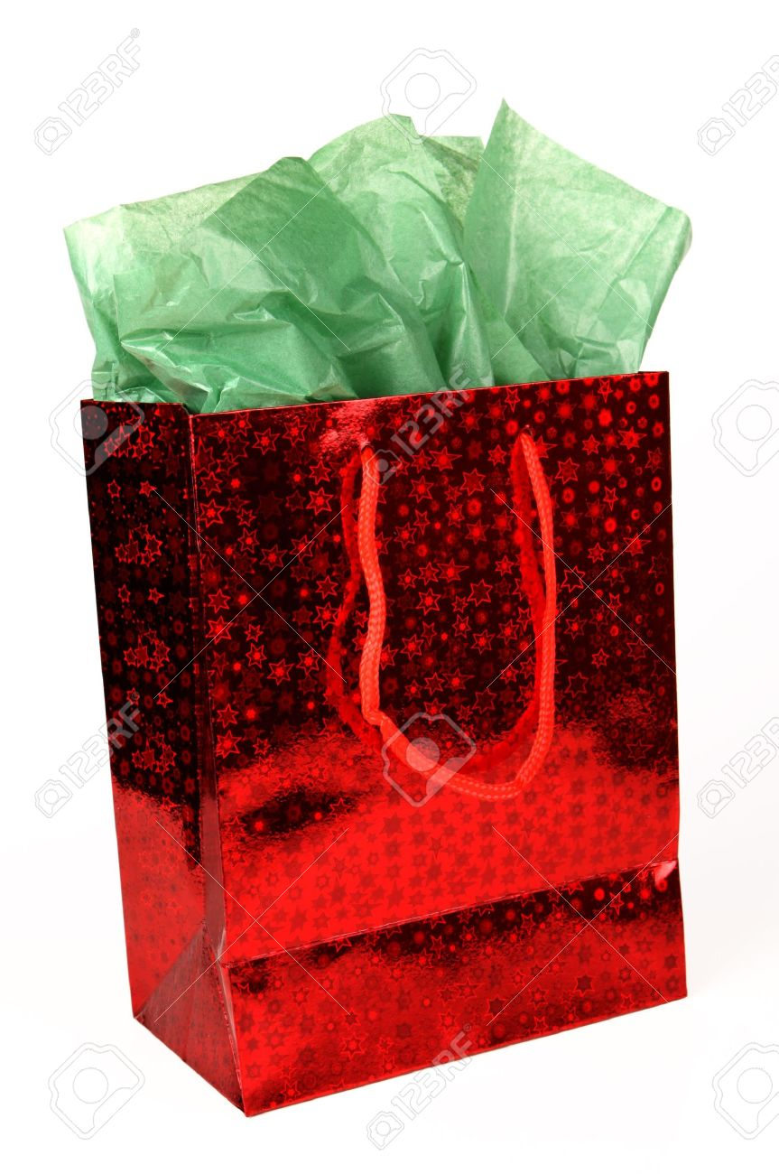 red shiny christmas gift bag with green tissue on white stock photo 7884795