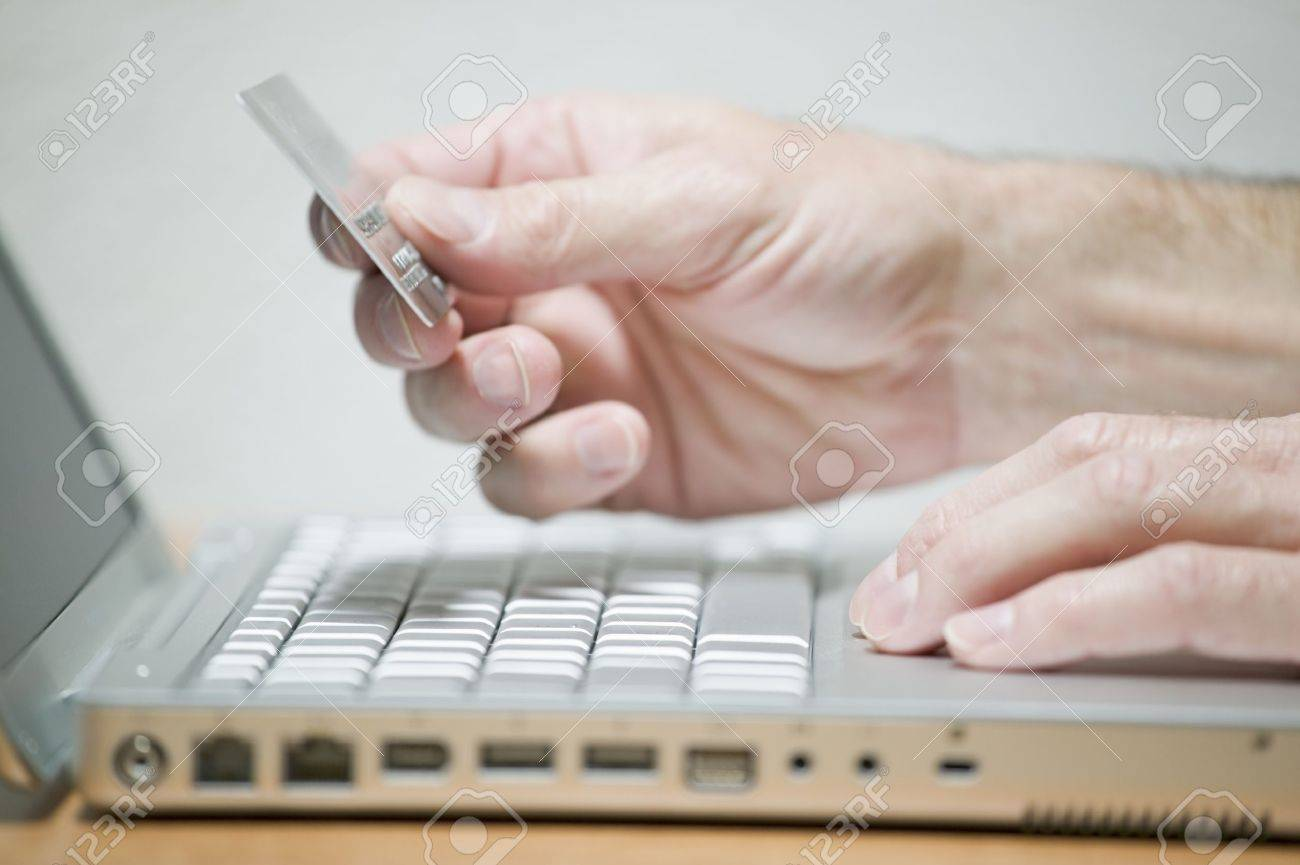 Man using credit card online, concept photography - 9645344