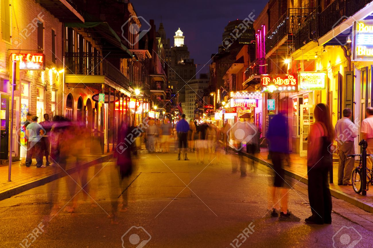 New Orleans, Louisiana, USA - August 31, 2008: Unidentified tourists and party goers enjoy the nightlife on Bourbon Street in New Orleans famous French Quarter. - 9671489