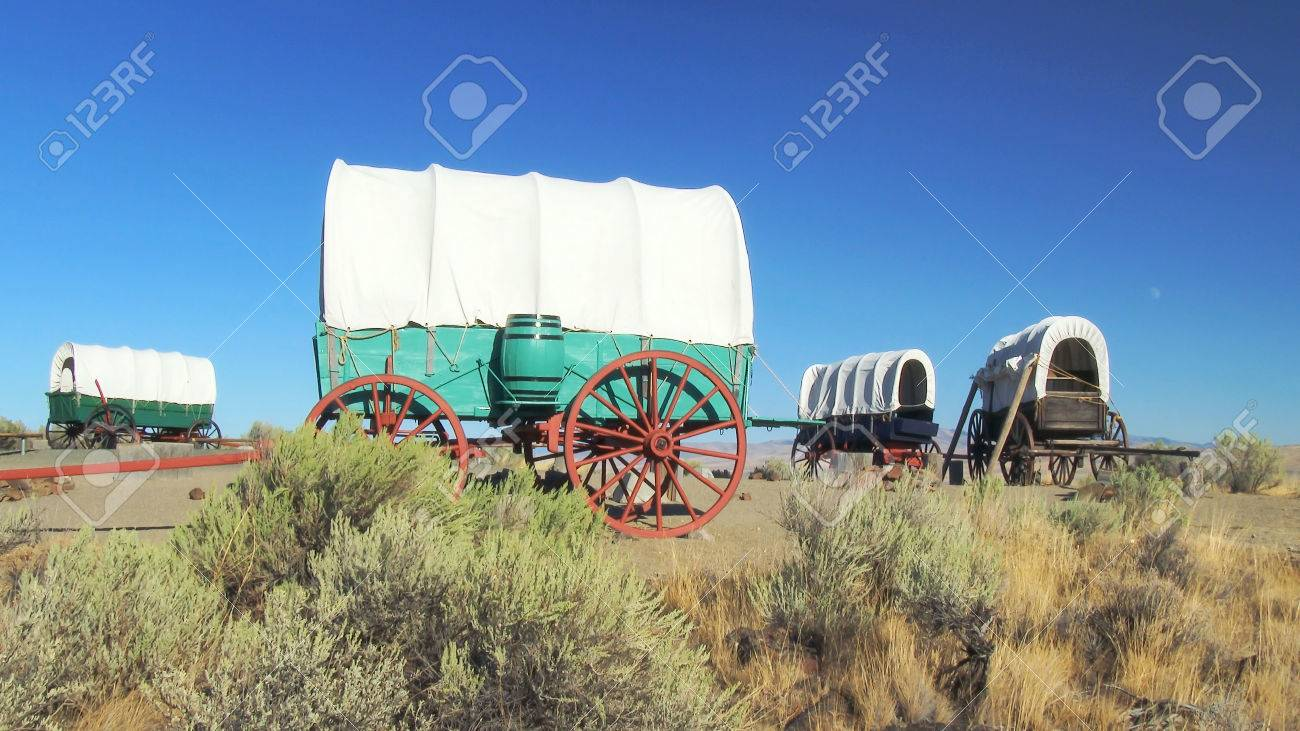 A covered wagon train forms a protective circle to camp along the Oregon Trail in eastern Oregon - 46182870